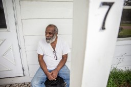 Jessie Parker, a native of New Orleans, sits on his front Thursday, April 11, 2019 in Belzoni, Miss.