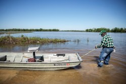 Anderson Jones Sr., 59, positions his boat as he gets ready to travel across flood water to get to his home in Fitler, Miss., Monday, April 15, 2019.