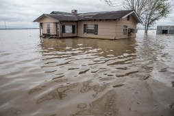 A home is nearly is surrounded by flood water in Issaquena County Friday, April 5, 2019.