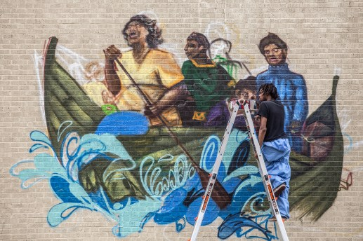 Nashville artist Woke 3 works to finish his mural as a part of Mural Fest in downtown Jackson, Wednesday, April 17, 2019.