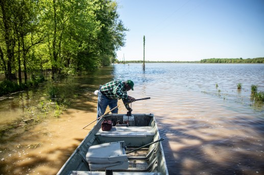 Anderson Jones Sr., 59, adjusts the small motor on his boat during his journey to his home in Fitler, Miss., Monday, April 15, 2019.