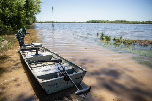 Anderson Jones Sr., 59, pulls his boat into the flood water in Fitler, Miss., Monday, April 15, 2019.