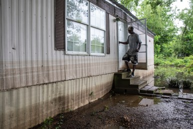 Willie Tucker walks out of a home that was severely damaged by the flooding in Tchula, Miss., Thursday, May 9, 2019.