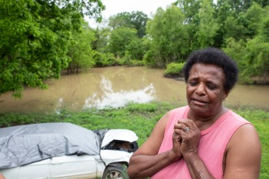 Jennie Jefferson expresses emotion as she talks about the recent flooding near her home and the damage it caused to her car in Tchula, Miss., Thursday, May 9, 2019. Jefferson is still making payments on her car, but she is unable to afford repairs.