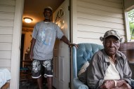 Geneva Williams, right, listens as her son, Willie Tucker, talks about the difficulties residents are facing caused by the flooding in Tchula, Miss., Thursday, May 9, 2019.