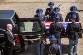 Members of a Mississippi Highway Patrol honor guard prepare to carry the casket of Sen. Thad Cochran into the state Capitol in Jackson, Miss., for a funeral service, Monday, June 3, 2019.