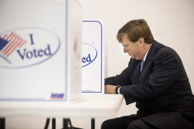 GOP gubernatorial candidate Tate Reeves votes at Liberty Baptist Church during the GOP runoff elections.