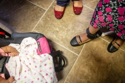 A woman who was detained during the U.S. Immigration and Customs Enforcement raids, right, wears an ankle bracelet while seeking legal advice at Alpha and Omega Church of Deliverance in Forest, Miss., Saturday, August 10, 2019.