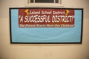 An encouraging poster is attached to a bulletin board at Leland Elementary School.