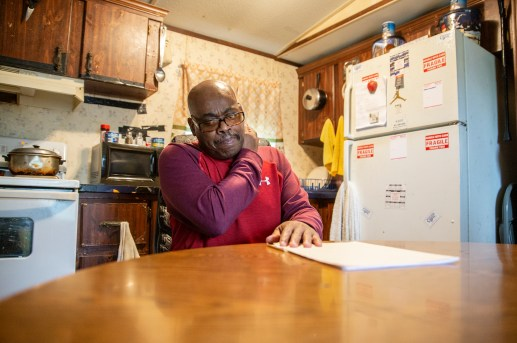 U.S. Army veteran Anthony Burkett looks over legal documents inside of his trailer in Seminary, Miss., Wednesday, October 30, 2019.