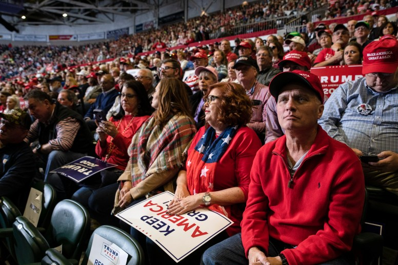 Supporters wait for President Donald Trump during the Trump rally at BancorpSouth Arena in Tupelo, Miss., Friday, November 1, 2019.