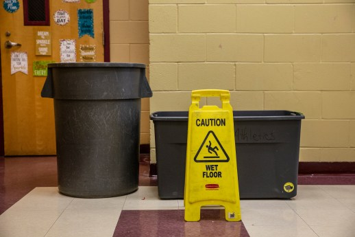 A trash can and a storage bin catches rain water at S.V. Marshall Elementary School in Lexington, Miss., Thursday, October 31, 2019.