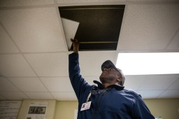Supervisor of Maintenance Alonzo Washington takes a look at the water damage inside of a classroom at Holmes County Central High School in Lexington, Miss., Thursday, October 31, 2019.