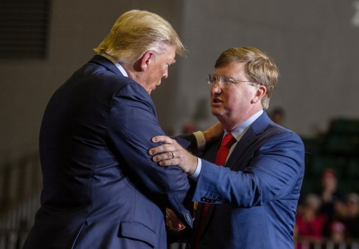 President Donald Trump embraces Lt. Gov. Tate Reeves during a campaign rally at BancorpSouth Arena in Tupelo, Miss., Friday, November 1, 2019.