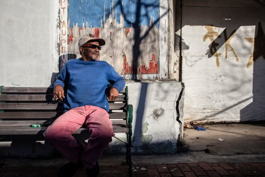 """Tony """"Dr. Shoemaker"""" Brothers sits across the street from his family's business, Dennis Brothers Shoe Repair Service, in the 300 block of Farish Street in Jackson Thursday, December 5, 2019."""