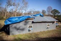 Tarp covers part of Zelma Davenport's home Thursday, December 19, 2019, after Monday's tornado in Edwards, Miss.