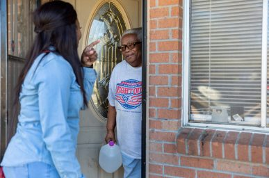 Coretta Frazier, left, gives Rosa Walton distilled water Thursday, Dec. 19, 2019, in Edwards, Miss. Frazier has been volunteering and delivering donated items to those affected by Monday's tornado.