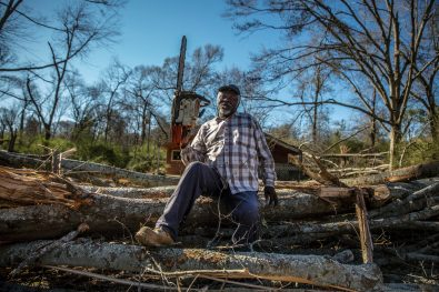 James Lane, a lifelong resident of Edwards, Miss., with his chainsaw Thursday, Dec. 19, 2019. Lane has been helping people in his hometown by cutting down trees in their yards. In return, he uses the fallen trees for firewood.