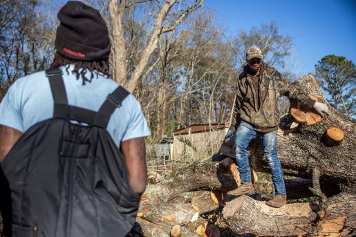 Carlos Jenkins, left, and Ahmadd White help Von Max remove several fallen trees from the yard of a resident of Edwards, Miss., Thursday, December 19, 2019.