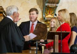 Gov. Tate Reeves is sworn into office during his inauguration ceremony inside the House chamber at the Capitol in Jackson, Miss. Jackson, Miss., Tuesday, Jan. 14, 2020.