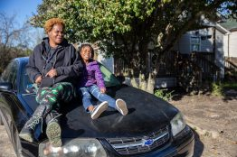 Angela Todd, left, and Zakiyah Todd sit on a car parked in their driveway near Mobile Street in Hattiesburg, Miss.,Friday, February 21, 2020.