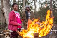 Patricia Watts, and Caria Strickland gather around a fire to keep warm on Dabbs Street in Hattiesburg, Miss., Friday, February 21, 2020.