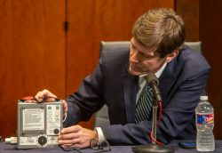 Mississippi State Health Officer Dr. Thomas Dobbs holds a ventilator during a press conference concerning the coronavirus pandemic.