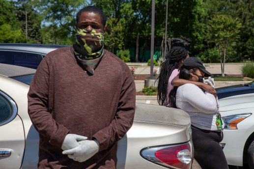 Kendrick Rogers, Shalondra Rollins' fiancé, stands in the parking lot outside Jackson Memorial Funeral Services, before her visitation on April 15, 2020. Family members wore masks and gloves and mostly stood apart as they grieved Rollins, who died from complications with COVID-19 on April 7.