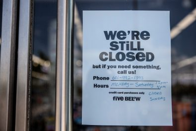 A sign notifying shoppers that Five Below is closed hangs on the business' door window Thursday, April 23, 2020, at the Dogwood Festival Market in Flowood, Miss.