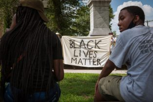 Protestors demand the Confederate statue come down outside the Bolivar County Courthouse in Cleveland, Mississippi on July 3, 2020. Photo by Rory Doyle.