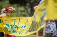 Dee Szot, 9, participates in a protests against the reopening of Mississippi schools.