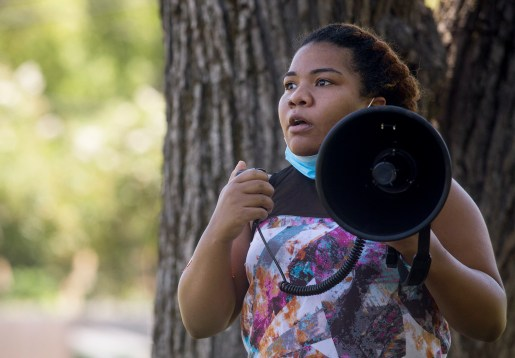 Ebonie Baker speaks to protesters during the Parents for Safe Schools Rally at Minnie Cox Park in Indianola, Miss., Thursday, July 23, 2020.