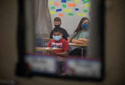 Students wear face masks as they sit in a classroom on the first day of school at Neshoba County Central Middle School, Wednesday, August 5, 2020.