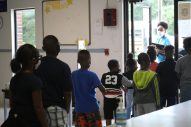 Children at the Boys and Girls Club Walker Unit in south Jackson line up for play time after finishing virtual learning for the day on Sept. 14, 2020. The Club usually operates as an after school program, but because of the COVID-19 pandemic and Jackson Public Schools closures, they've met a need in the community for dozens of working families.