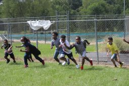 Children of the Boys and Girls Club Walker unit race each other in the yard after completing their distance learning for the day on Sept. 14, 2020. The kids must wear masks and remain socially distanced while they play due to the COVID-19 pandemic.