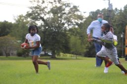 Kids at the Boys and Girls Club Walker unit in south Jackson play touch football after the school day on Sept. 14, 2020.