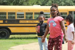 Shykeria, far left, and Doria, center, play with a hula hoop at the Boys and Girls Club Walker unit in south Jackson on Sept. 14, 2020.