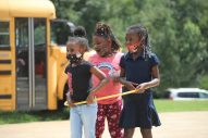 Shykeria, Doria and Skylar play inside a hula hoop at the Boys and Girls Club Walker unit in south Jackson on Sept. 14, 2020.