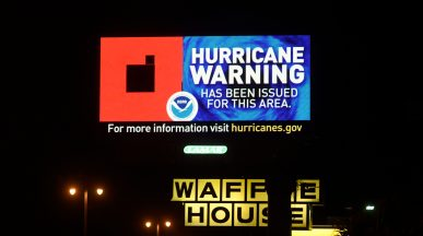 An electronic billboard on U. S. 90 in Gulfport displays the Hurricane Warning for Tropical Storm Sally. The storm is expected to strengthen to a potential Category 2 hurricane before making landfall.