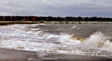 Waves crash ashore near Urie Pier at Gulfport Tuesday morning. The Mississippi Gulf Coast was bracing for a direct hit from Sally, but the storm is now moving eastward toward Mobile, Ala.