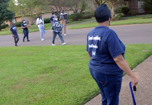 Valley North Subdivision resident Caroline Dace watches as Democratic U.S. Senate challenger Mike Espy approaches with a campaign sign she requested for her yard. Espy and campaign workers canvassed the north Jackson neighborhood on Oct. 23.