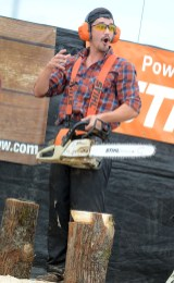 Zack the Lumberjack eggs on the crowd, asking if they'd like to see his bunny carved masterpiece.