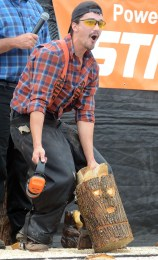 Zack the Lumberjack reveals his bunny carved masterpiece to a stunned, then laughing crowd.