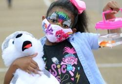 Autumn Johnson, 7 of Ridgeland, shows off her State Fair bounty.