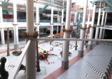 """A worker paints column decoration at the Metrocenter Mall recently in preparation for a """"soft opening"""" of a portion of the upper level of the mall later this month."""