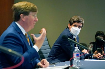 "State health officer Dr. Thomas Dobbs, right, listens Tuesday, Dec. 1, 2020, in Jackson, Miss., as Gov. Tate Reeves announces 13 additional counties that have qualified and met certain requirements to be placed under mask mandates with his ""Safe Recovery"" executive order that is in effect until Dec. 11. (AP Photo/Rogelio V. Solis)"