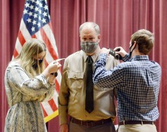 "Morgan Kelly (left) and her brother John Forrest Kelly, change the epaulets on the uniform of their father, Major General John ""Trent"" Kelly to reflect his promotion from Brigadier General to Major General during a ceremony held Saturday at the Mississippi National Guard Joint Force Headquarters in Jackson."