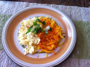 Top with scrambled eggs and scallions