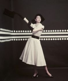 Model Suzy Parker in collared blouse and half-circle skirt