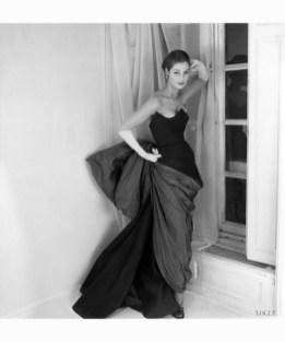 Fiona Campbell Walter in a Schiaparelli dress with venus de milo drapery for Vogue March 1952